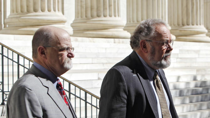Defense attorneys Ron Yengich, left, and Pat Shea leave the federal courthouse in Denver after oral arguments before the 10th Circuit U.S. Court of Appeals in the appeal of the conviction of environmental activist Tim DeChristopher, Thursday, May 10, 2012. DeChristopher was convicted of disrupting the sale of oil and gas leases on public lands near Utah's national parks and is serving two years in a federal prison in California. (AP Photo/Ed Andrieski)