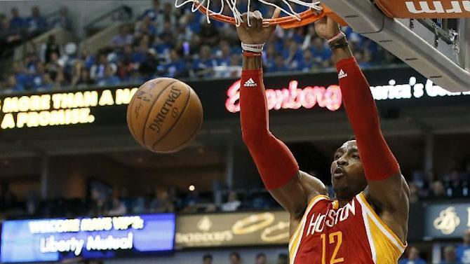 Dallas Mavericks' Charlie Villanueva, bottom, is unable to stop a dunk by Houston Rockets' Dwight Howard (12) in the first half of Game 4 in an NBA basketball first-round playoff series Sunday April 26, 2015, in Dallas. (AP Photo/Tony Gutierrez)