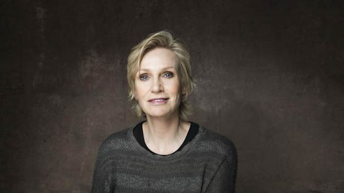 """FILE - This Jan. 21, 2013 file photo shows actress Jane Lynch during the 2013 Sundance Film Festival at the Fender Music Lodge in Park City, Utah. Lynch said Wednesday, Feb. 20, she'll be replacing Tony Award-winning actress Katie Finneran as the evil orphanage matron Miss Hannigan in the current revival of """"Annie.""""  A veteran of Chicago's Steppenwolf Theatre Company, she will play Hannigan for eight weeks, from May 16 through July 14. (Photo by Victoria Will/Invision/AP, file)"""