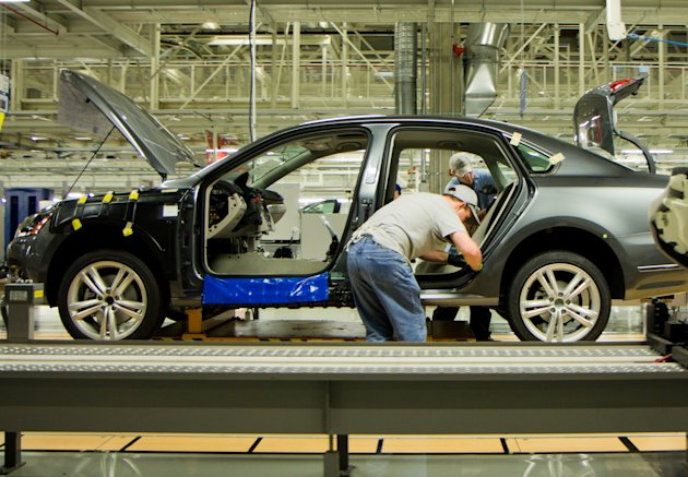 FILE - In this March 22, 2012, file photo, workers assemble a Passat sedan at Volkswagen AG's plant in Chattanooga, Tenn. The German automaker is conducting a national ad campaign to attract skilled w