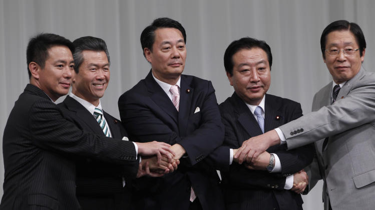 Candidates for the leader of Japan's ruling Democratic Party, from left, former Foreign Minister Seiji Maehara, former Transport Minister Sumio Mabuchi, Trade and Economy Minister Banri Kaieda, Finance Minister Yoshihiko Noda and Farm Minister Michihiko Kano, join their hands prior to a debate in Tokyo Sunday, Aug. 28, 2011. The five candidates vying to become Japan's next prime minister promised to resolve the country's nuclear crisis and revive its battered economy, amid widespread public cynicism about a revolving door of leaders. (AP Photo/Shizuo Kambayashi)