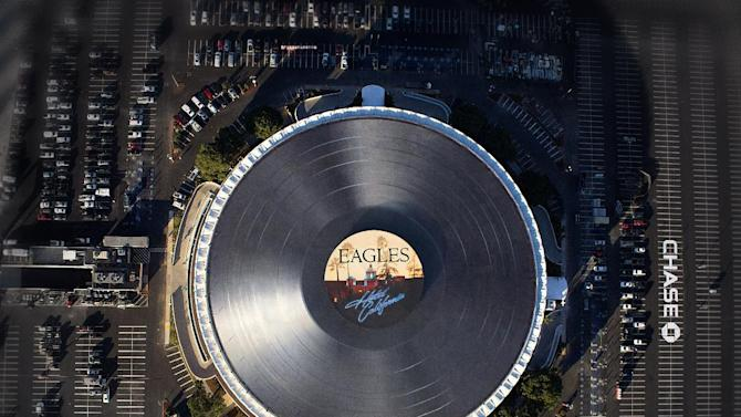 "This photo released by the Forum shows the Eagles' multi-platinum ""Hotel California"" as the world's largest vinyl record on top of the Forum to kick-off the Eagles six concerts Jan. 15-25, 2014 and the grand reopening of the venue, in Inglewood, Calif. The giant ""Hotel California"" record will be spinning on top of the Forum through the Eagles' six concerts to celebrate its reopening. (AP Photo/Forum)"