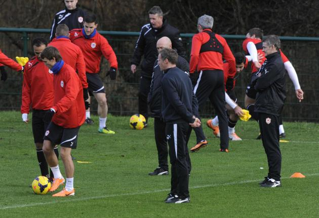 Cardiff City manager Solskjaer watches his players in training at the Vale hotel in Hensol, Vale of Glamorgan