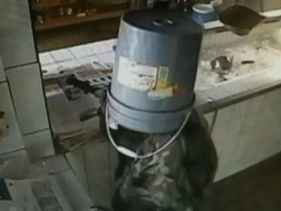 Raw: Burglar With Five Gallon Bucket on His Head