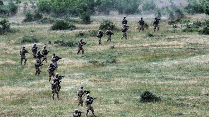 US army soldiers take part in a joint military drill with Bulgaria's army at Novo Selo military ground on June 25, 2015