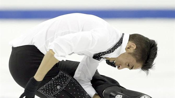 ZEN062. Shanghai (China), 28/03/2015.- Chafik Besseghier from France performs in the Men Free Skating of the 2015 ISU World Figure Skating Championships at Shanghai Oriental Sports Center in Shanghai, China, 28 March 2015. (Francia) EFE/EPA/TATYANA ZENKOVICH