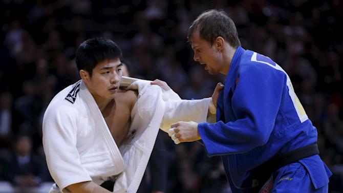 South Korea's An Chang-Rim challenges Denis Iartcev of Russia in their men's under 73kg final match at the Paris International Grand Slam judo tournament, France