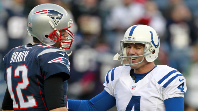 Former teammates, New England Patriots quarterback Tom Brady (12) and Indianapolis Colts kicker Adam Vinatieri (4) talk prior to an NFL football game at Gillette Stadium in Foxborough, Mass., Sunday, Nov. 18, 2012. (AP Photo/Steven Senne)