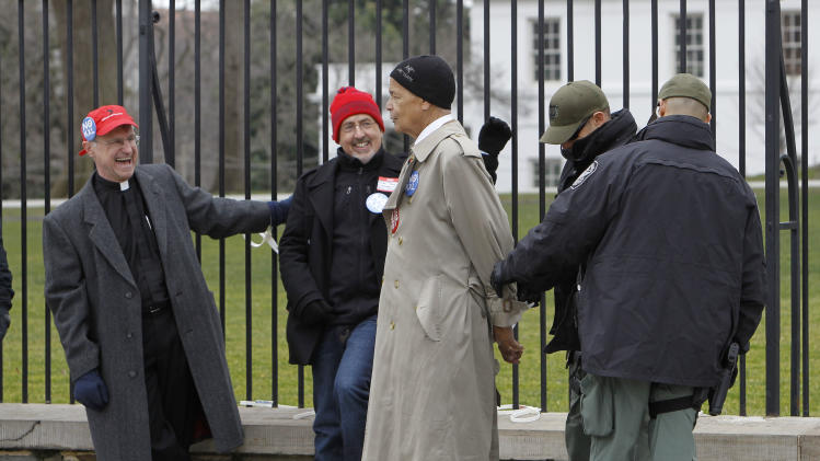 Civil rights leader Julian Bond is arrested outside the White House in Washington, Wednesday, Feb. 13, 2013, as prominent environmental leaders tied themselves to the White House gate to protest the Keystone XL oil pipeline..  (AP Photo/Ann Heisenfelt)