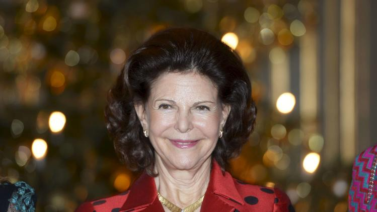 Queen Silvia poses during a reception in connection with her 70th birthday at the Royal Palace in Stockholm