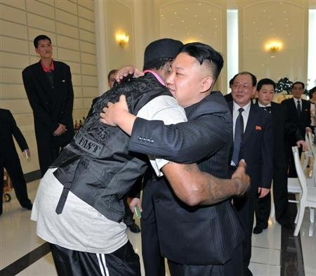North Korean leader Kim Jong-Un and former NBA basketball player Dennis Rodman (front L) hug in Pyongyang in this undated picture released by North Korea's KCNA news agency on March 1, 2013.