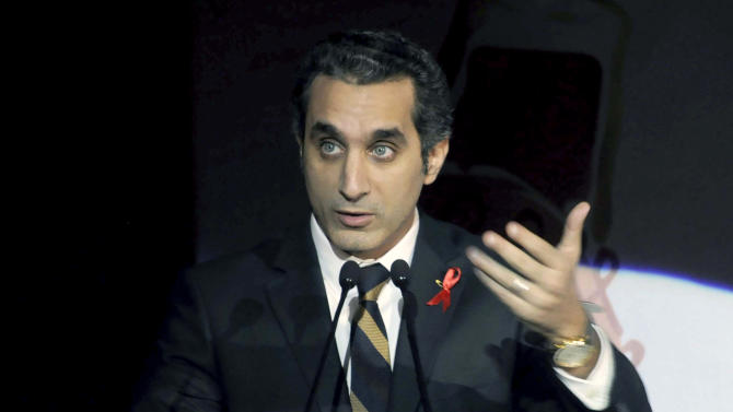 FILE - In this Saturday Dec. 8, 2012 file photo, Egyptian TV host Bassem Youssef addresses attendants at a gala dinner party in Cairo, Egypt. Egypt's state news agency said Saturday, March 30, 2013 that the public prosecution office has issued an arrest warrant against a popular TV satirist for allegedly insulting Islam and the country's president. The warrant issued Saturday is the latest in a series of legal action against Youssef, known as Egypt's Jon Stewart. The warrant comes amid a widening crackdown against opposition figures, driving fears over freedoms of expression and assembly. (AP Photo/Ahmed Omar, File)