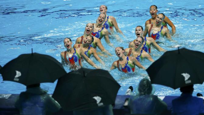 Judges watch team Canada during the women's synchronised swimming free routine combination final at the Aquatics World Championships in Kazan