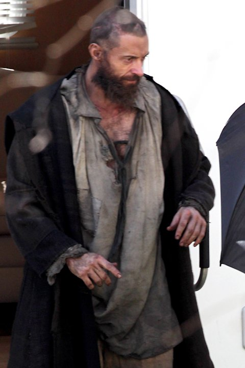 Hugh Jackman as prisoner Jean Valjean in 'Les Miserables.' Great lengths were taken to shield his bedraggled appearance, including a livid scar on the side of his head in London, UK. (photo by SplashN