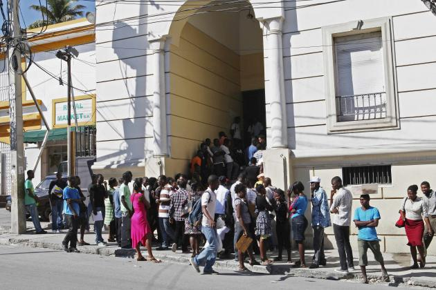 Haitians line up to apply for visas outside the Brazilian embassy in Port-au-Prince November 22, 2013.