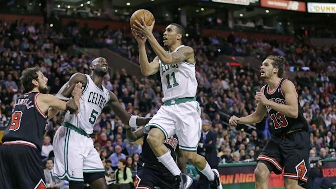Boston Celtics guard Courtney Lee (11) drives past Chicago Bulls center Joakim Noah, right, during the first half of an NBA basketball game in Boston on Friday, Jan. 18, 2013. At left are Celtics forward Kevin Garnett (5) and Bulls guard Marco Belinelli (8). (AP Photo/Charles Krupa)