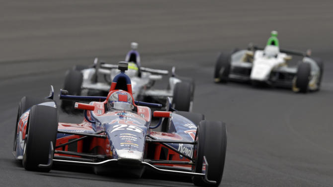 Marco Andretti drives through the first turn during the Indianapolis 500 auto race at Indianapolis Motor Speedway in Indianapolis, Sunday, May 26, 2013. (AP Photo/Tom Strattman)