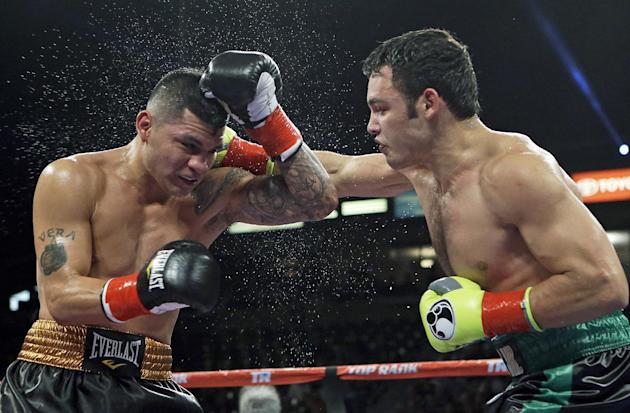 Julio Cesar Chavez Jr, right, lands a right to Brian Vera in the sixth round of a 10-round boxing match between Chavez, the former World Boxing Council (WBC) middleweight champion, and Vera, the conte