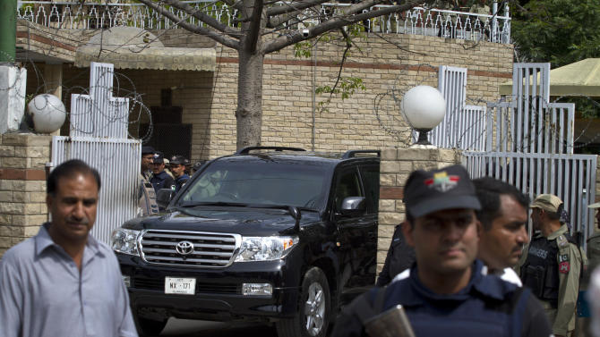 A vehicle carrying Pakistan's former President and military ruler Pervez Musharraf leaves the anti-terrorism court in Rawalpindi, Pakistan, Tuesday, April 23, 2013. Musharraf appeared before anti-terrorism court over the assassination of former Prime Minister Benazir Bhutto's case, official said.  (AP Photo/Anjum Naveed)