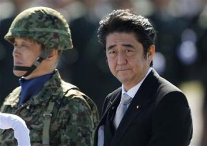 Japan's Prime Minister Shinzo Abe reviews Japan Self-Defence Forces troops in Asaka, Japan