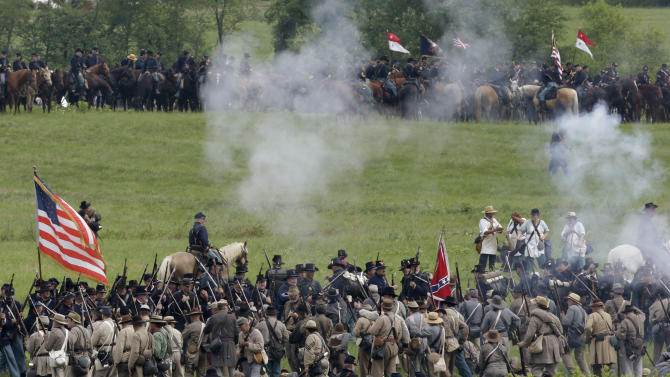Reenactors demonstrate a battle during ongoing activities commemorating the 150th anniversary of the Battle of Gettysburg, Friday, June 28, 2013, at at Bushey Farm in Gettysburg, Pa. Union forces turned away a Confederate advance in the pivotal battle of the Civil War fought July 1-3, 1863, which was also the war's bloodiest conflict with more than 51,000 casualties. (AP Photo/Matt Rourke)