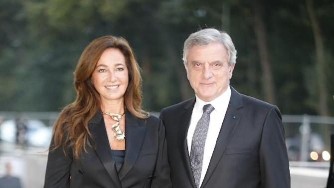 Dior fashion house CEO Sidney Toledano and his wife Katia arrive at the inauguration of architect Frank Gehry's latest creation, the Louis Vuitton Foundation art museum and cultural center in Paris, Monday, Oct. 20, 2014. The 100-million-euro building, with billowing glass casing and 11 gallery spaces, has been compared to an iceberg or giant sailboat and took over a decade to make. (AP Photo/Jacques Brinon)