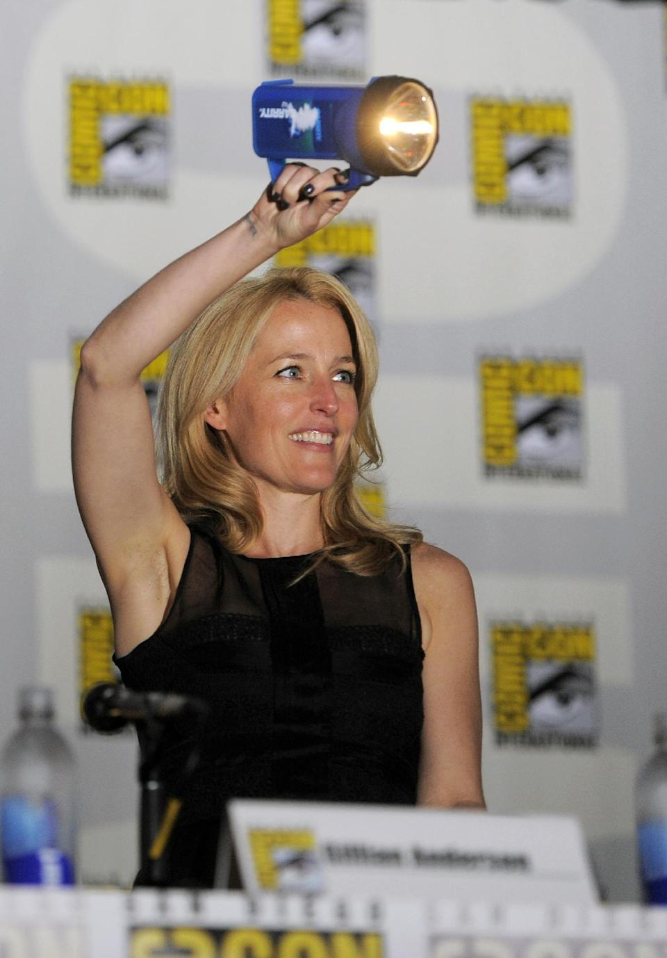 "Gillian Anderson attends the ""The X Files"" 20th Anniversary panel on Day 2 of Comic-Con International on Thursday, July 18, 2013 in San Diego, Calif. (Photo by Chris Pizzello/Invision/AP)"