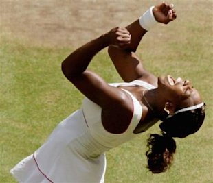 Defending champion Serena Williams reacts as she defeats Vera Zonareva to win the women's singles final on the Centre Court at the All England Lawn Te