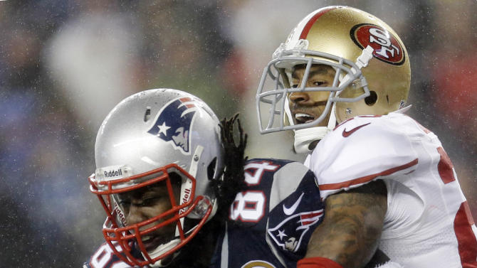 San Francisco 49ers cornerback Tarell Brown, right, breaks up a pass in the end zone intended for New England Patriots wide receiver Deion Branch (84) in the second quarter of an NFL football game in Foxborough, Mass., Sunday, Dec. 16, 2012. (AP Photo/Elise Amendola)