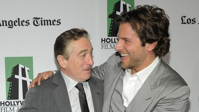 "Robert De Niro, left, recipient of the Hollywood Supporting Actor Award, is greeted by Bradley Cooper, recipient of the Hollywood Actor Award, at the 16th Annual Hollywood Film Awards Gala on Monday, Oct. 22, 2012, in Beverly Hills, Calif. De Niro and Cooper are cast members in the forthcoming film ""Silver Linings Playbook."" (Photo by Chris Pizzello/Invision/AP)"