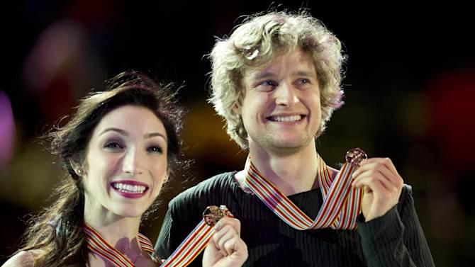 Gold medallists Meryl Davis and Charlie White, of the United States, pose with their medals on the podium after winning the ice dancing competition at the World Figure Skating Championships in London, Ontario, Saturday March 16, 2013. (AP Photo/The Canadian Press, Paul Chiasson)