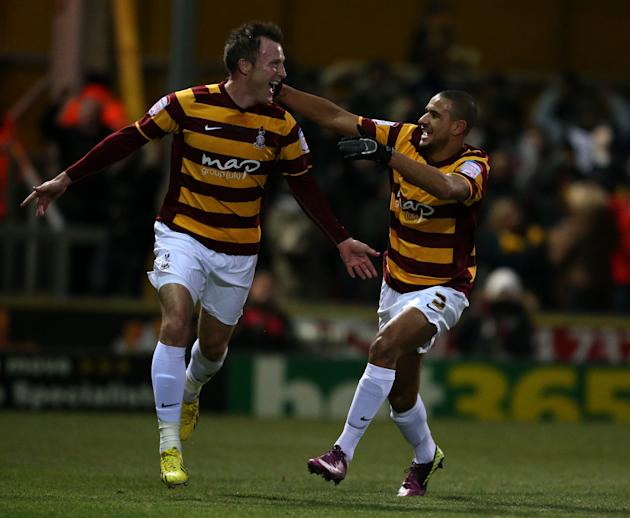 Garry Thompson, left, netted Bradford's opener against Arsenal