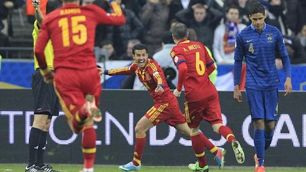 2013Spain's Pedro Rodriguez Ledesma (C) celebrates after scoring goal against France during their 2014 World Cup qualifying soccer match at the Stade de France stadium in Saint-Denis, near Paris, March 26, 2013.