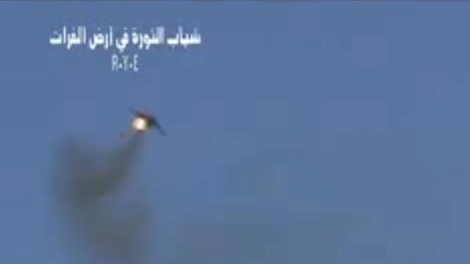 This image made from amateur video released by the R.Y.E. Syria and accessed Monday Aug. 13, 2012, purports to show a Syrian plane downed over the eastern province of Deir el-Zour, Syria, Monday Aug. 13, 2012. Activists released a video which they claim shows a government Soviet-made MiG warplane catching fire apparently after it was hit by ground fire while Syrian state-run media said Monday a pilot ejected from a warplane on a training mission after a technical failure. (AP Photo/R.Y.E. Syria) THE ASSOCIATED PRESS IS UNABLE TO INDEPENDENTLY VERIFY THE AUTHENTICITY, CONTENT, LOCATION OR DATE OF THIS HANDOUT PHOTO