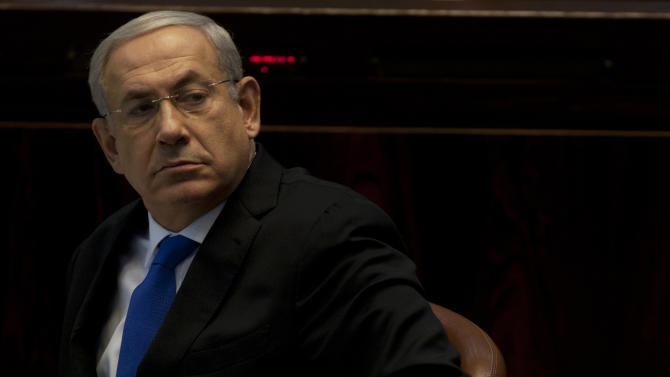 Israeli Prime Minister Benjamin Netanyahu looks on during a session at the Knesset, Israel's parliament in Jerusalem, Monday, Oct. 15, 2012. Israel's parliament has gathered for a vote to dissolve itself and hold early parliamentary elections. (AP Photo/Sebastian Scheiner)
