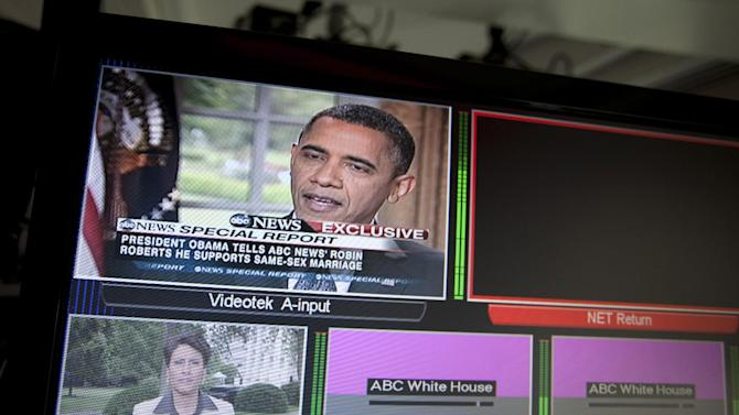 FILE - In this May 9, 2012, file photo President Barack Obama is seen on a White House television in Washington during an interview with ABC News where he said he supports gay marriage. Voters in this presidential election may face the starkest choice ever on the hot-button social issues of same-sex marriage, abortion rights and access to birth control. Most voters tell pollsters that the economy is their chief concern. But advocacy groups on the left and right are in high gear _ with bus tours, YouTube videos and fundraising _ pointing out the sharp differences between the parties in the current phase of the culture wars. The upcoming conventions will highlight the contrasts between the parties on abortion and other issues. (AP Photo/Carolyn Kaster, File)