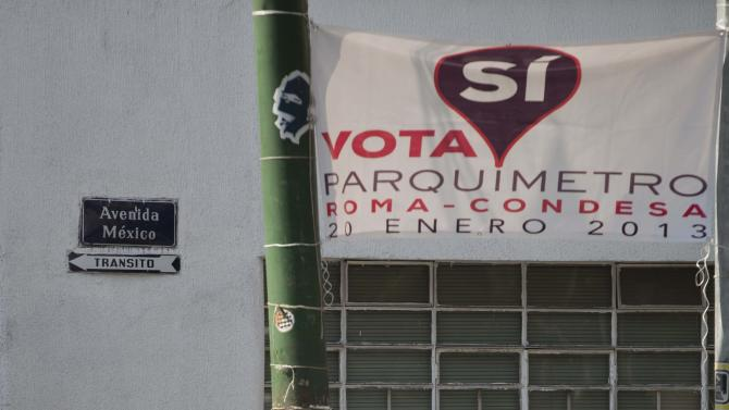 "A sign hangs on a residence encouraging a ""yes"" vote in an upcoming referendum regarding the installation of parking meters in the Condesa neighborhood of Mexico City, Friday, Jan. 18, 2013.  Many are vehemently opposed,  saying the streets are public and no one should profit from them. But others hope the plan will cut down on cars from elsewhere. On Sunday, Condesa's residents will decide in a referendum whether they want the meters on their streets. (AP Photo/Eduardo Verdugo)"