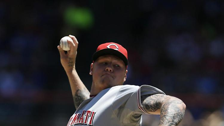 Cincinnati Reds starting pitcher Mat Latos works against the Texas Rangers in the first inning of a baseball game Sunday, June 30, 2013, in Arlington, Texas. (AP Photo/Tony Gutierrez)