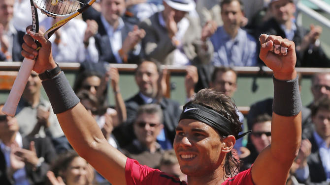 Rafael Nadal of Spain celebrates winning his semi final match against compatriot David Ferrer at the French Open tennis tournament in Roland Garros stadium in Paris, Friday June 8, 2012. Nadal won in three sets 6-2, 6-2, 6-1. (AP Photo/Michel Euler)