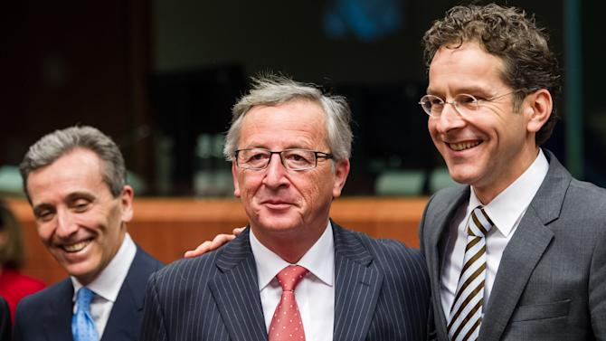 President of the Eurogroup Jean-Claude Juncker, center,  talks with Dutch finance minister Jeroen Dijsselbloem, right, as Italy's Finance Minister Vittorio Grilli, left walks by during an Eurogroup finance ministers meeting at the EU Council in Brussels on Monday, Jan. 21, 2013. (AP Photo/Geert Vanden Wijngaert)