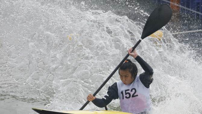 Taiwan's Chang Chu Han competes during the women's kayak single slalom final event at the Hanam Misari Canoe/Kayak Centre, during the 17th Asian Games in Incheon