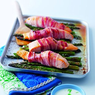 Pancetta-wrapped salmon with griddled asparagus and lime crème fraîche