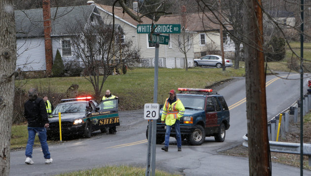 Emergency responders block Juniata Valley Road on Friday, Dec. 21, 2012 in Geeseytown, Pa. A man fatally shot a woman decorating for a children&#39;s Christmas party at a tiny church hall and killed two men elsewhere in the rural central Pennsylvania township Friday before he was fatally shot in a gunfight with state troopers. (AP Photo/Keith Srakocic)