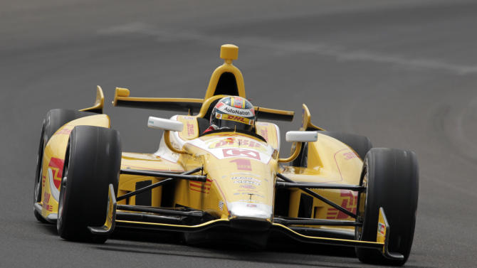 Ryan Hunter-Reay drives through the first turn on his qualification run on the first day of qualifications for the Indianapolis 500 auto race at Indianapolis Motor Speedway in Indianapolis, Saturday, May 18, 2013. (AP Photo/AJ Mast)