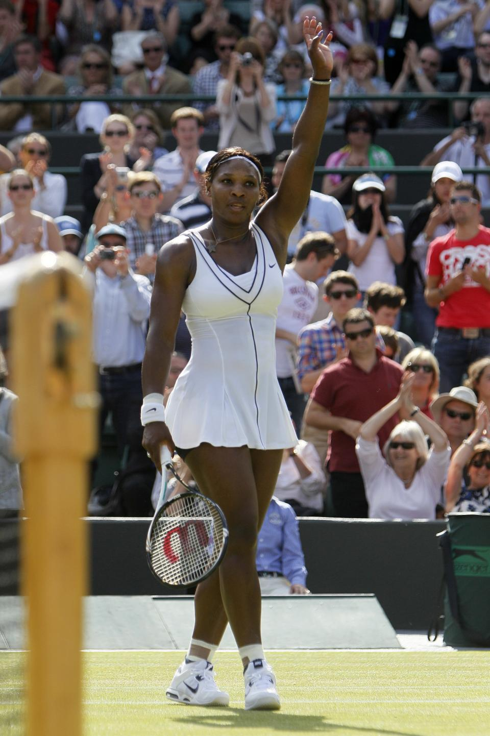 Serena Williams of the US celebrates after her win over Russia's Maria Kirilenko at the All England Lawn Tennis Championships at Wimbledon, Saturday, June 25, 2011. (AP Photo/Alastair Grant)