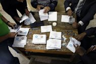 Election officials count ballots at a polling station in Cairo on December 15, 2012. Egypt&#39;s opposition has called for mass protests on Tuesday after Islamists backing President Mohamed Morsi claimed victory in the first round of a referendum it alleges was riddled with polling violations