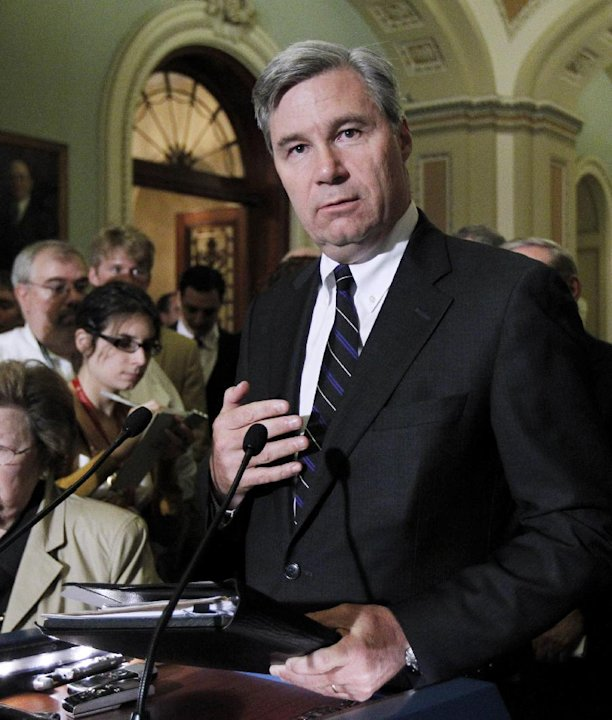 In this photo taken June 29, 2011, photo Sen. Sheldon Whitehouse, D-R.I., speaks to reporters on Capitol Hill in Washington. Whitehouse is among a small group in the Senate pushing campaign finance re