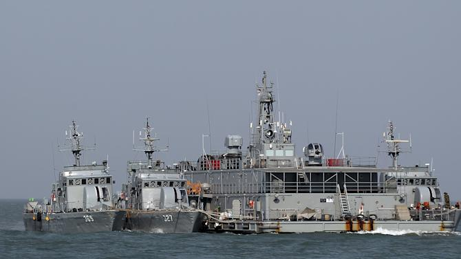 South Korean navy ships are seen at a floating base near South Korea's western Yeonpyong Island near the disputed sea border with North Korea, South Korea, Monday, Feb. 20, 2012. South Korea on Monday conducted live-fire military drills from five islands near its disputed sea boundary with North Korea, despite Pyongyang's threat to attack. (AP Photo/Yonhap, Bae Jung-hyun) KOREA OUT
