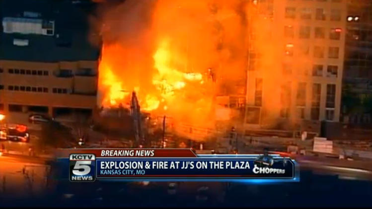 In this image taken from video from KCTV, firefighters battle a massive fire at Country Club Plaza in Kansas City, Mo. Tuesday, Feb. 19, 2013. A car crashed into a gas main Tuesday evening in an upscale Kansas City shopping district, sparking a massive blaze that engulfed an entire block and caused multiple injuries, police said. (AP Photo/KCTV) MANDATORY CREDIT: KCTV
