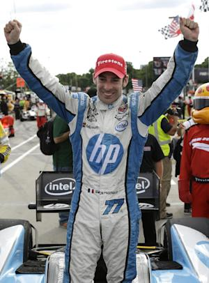 Simon Pagenaud, of France, celebrates his victory in the IndyCar Detroit Grand Prix auto race on Belle Isle in Detroit, Sunday, June 2, 2013. (AP Photo/Paul Sancya)